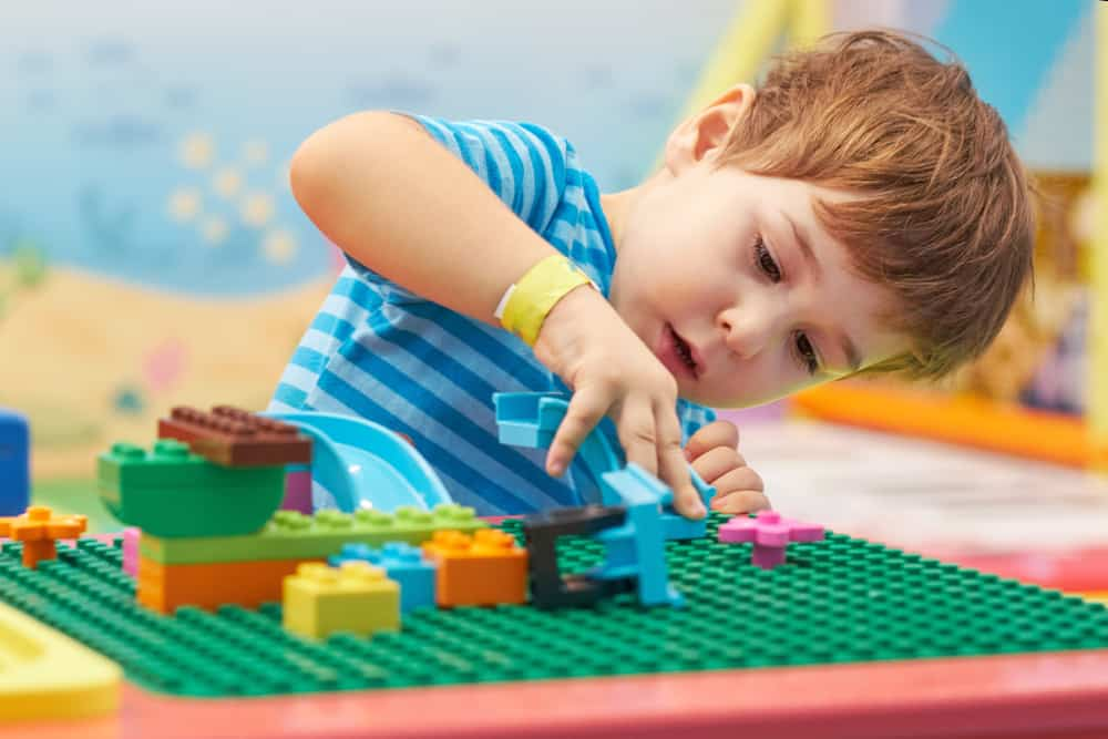Little boy playing with Legos