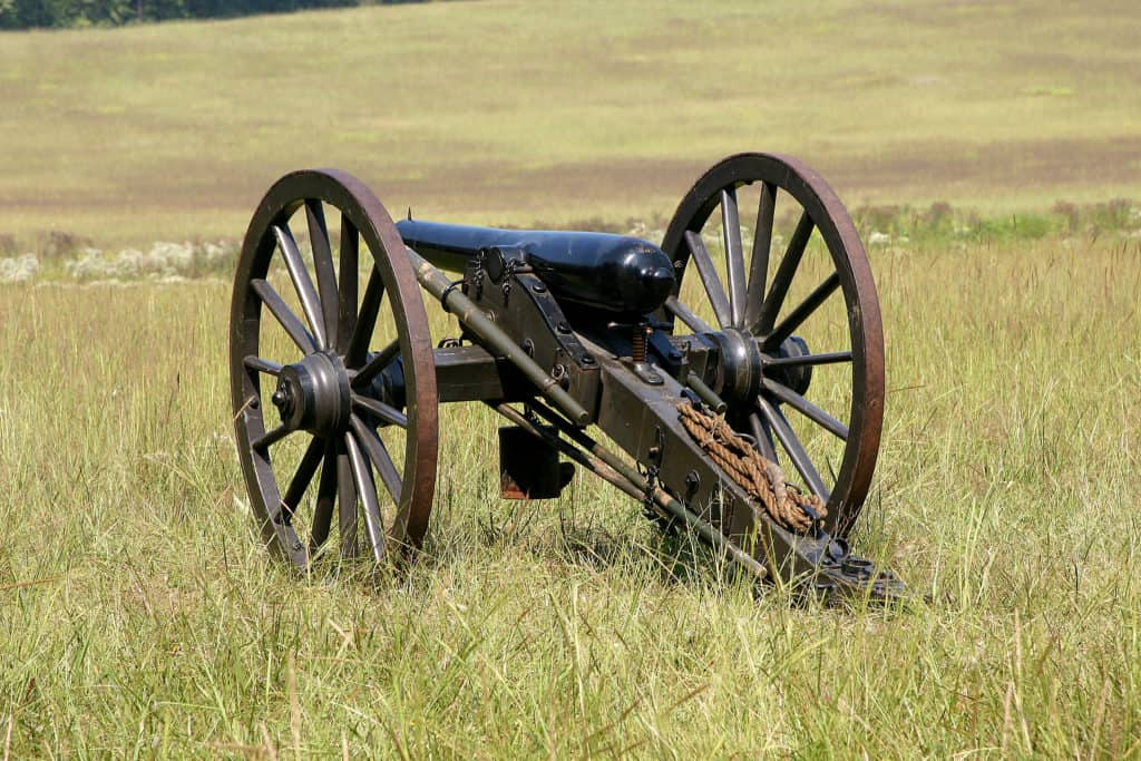 Old cannon on grass field